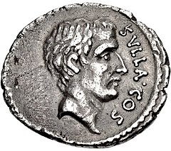 Grey coin with male head facing right
