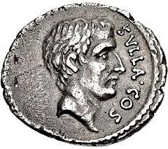 Moneta grigia con testa maschile rivolta a destra