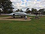 RAAF (A77-871) Gloster Meteor WK791 F8 and (A8-142) General Dynamics F111C gate guardians at RAAF Base Wagga.jpg