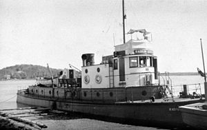 Fitzgerald, Alberta - The Radium Queen, and other tugboats, pushed barges to and from the portage at Fort Fitzgerald to the railhead at Waterways, Alberta.