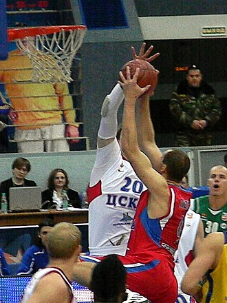 EuroLeague Basketball Legend Award - Ramūnas Šiškauskas in red, with the ball, during the 2011 Russian PBL All-Star Game.