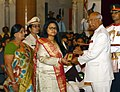 Ram Nath Kovind presenting the Kirti Chakra to Commandant Pramod Kumar (Posthumous) the award received by his wife Smt. Neha Tripathi and mother Smt. Kusum Devi, at the Defence Investiture Ceremony-II, at Rashtrapati Bhavan.JPG