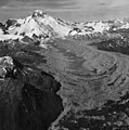 Red Glacier and Illiamna Volcano, mountain glacier foreground mostly covered in rocks and other debris, and icefall on the (GLACIERS 6725).jpg