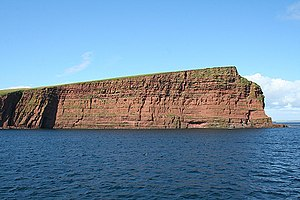 Eday - Exposure of Old Red Sandstone: Red Head at the north end of Eday. The lower and steeper part of the cliff is formed of Middle Eday Sandstone, whereas the upper less steep part is formed  of Eday Marl