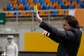 Sabre (fencing) - A referee shows a yellow card for a forbidden flèche in the 2014 Orléans Grand Prix