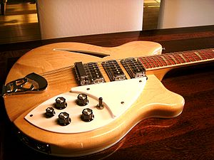 Rickenbacker - Body of a 370/12, with the distinctive R-tailpiece, sharkfin inlays and stereo jacks.