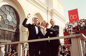 Unsolved Mysteries - Host Robert Stack (left, waving) defined the tone of Unsolved Mysteries.