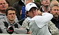 Rory McIlroy watches drive flight (crowd, landscape orientation).jpg