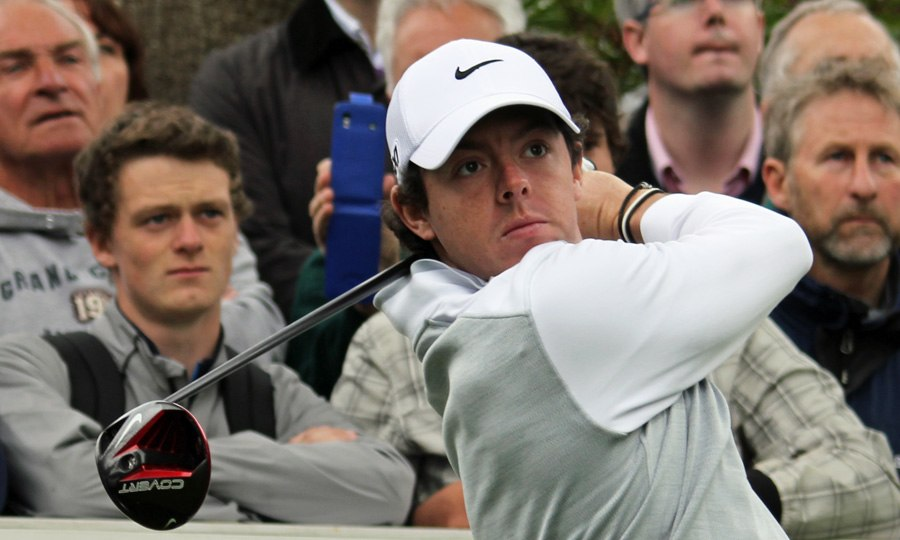 Rory McIlroy watches drive flight (crowd, landscape orientation)