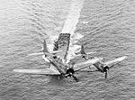 SBDs fly over USS Enterprise (CV-6) in November 1943.jpg