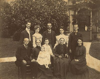 "Samuel Dibble family of Orangeburg, South Carolina.Front row: Samuel Dibble, his wife Mary Christiana Louis Dibble, their grandchild Mary Caroline Moss, Samuel Dibble Moss (known as Dibble Moss), Ann Agnes Hall Louis (widow of Deopold Louis); Frances Agnes Dibble Moss(known as Agnes Moss). Back row: Louis Virgil Dibble; Annie Leak Wyatt Dibble; Samuel Dibble II, Mary Henley Dibble (""May"" - later Mrs. W.W. Watson); Benjamin Hart Moss."