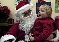 Santa, left, talks with a young boy during a gathering before the annual holiday tree lighting event in Roy, Wash., Dec. 6, 2013 131206-A-PP158-002.jpg