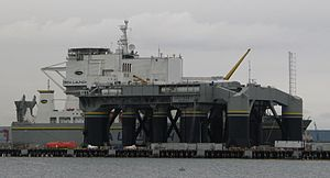 Odyssey (launch platform) - Odyssey at port, with Sea Launch Commander behind