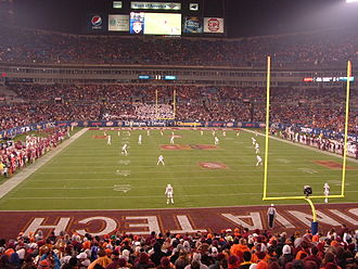 Kickoff (gridiron football) - End zone view of a kickoff about to occur. The Florida State Seminoles, in garnet jerseys, at the far side of the field are about to kick to the Virginia Tech Hokies in white jerseys, in the foreground.