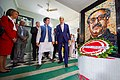 Secretary Kerry Walks Past a Wreath he Laid at a Memorial in Dhaka (28692595723).jpg