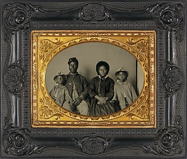 Sgt. Samuel Smith, African American soldier in Union uniform with wife and two daughters