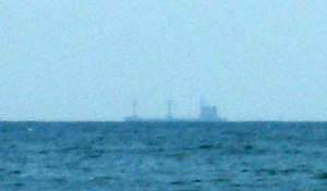 Flat Earth - When a ship is at the horizon, its lower part is obscured due to the curvature of the Earth.