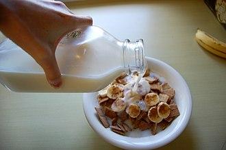 Skimmed milk - Skimmed milk being poured into a cereal bowl.