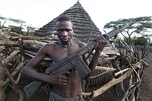 South Sudanese Civil War - A South Sudanese man holding a HK G3