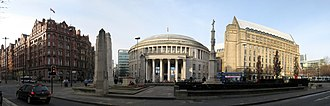 St Peter's Square, Manchester - A panoramic view of St Peter's Square. From the far left to right: Midland Hotel, Manchester Central Library and Manchester Town Hall extension; foreground Cenotaph and cross