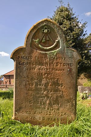 """Cowley Barracks - Headstone in St James' parish churchyard, Cowley, Oxfordshire of George and Sarah Stone. George had been Depot Sergeant Major in the Oxfordshire Light Infantry, presumably at Cowley Barracks. An eroded trace of the number """"52"""" is visible in the regimental badge carved at the top of the stone."""