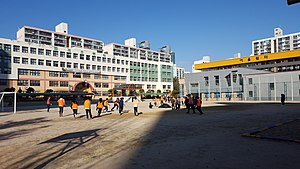 Students Playing Soccer in Bumgae Elementary School.jpg