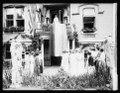 Suffragettes, Miss Paul raising suffrage ratification banner LCCN2016852154.tif
