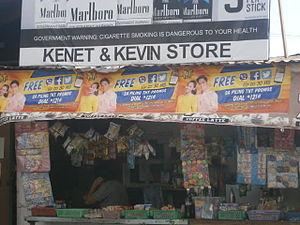 TNT (cellular service) - A TNT promo streamers featuring, the AlDub loveteam in a sari-sari store in Holy Spirit, Quezon City.