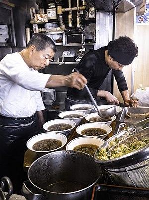 Ramen shop - Chefs preparing ramen dishes at a ramen shop in Tokyo