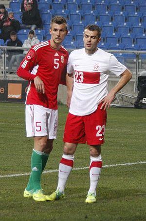 Tamás Priskin - Tamás Priskin and Poland's Paweł Brożek in 2011