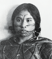 Tattooed Netsilik woman, by photographer Albert Peter Low.png