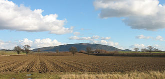 The Wrekin - The Wrekin viewed from near Atcham, Shropshire, with the A5 dual-carriageway visible in the middle distance.