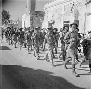 7th Armoured Division (United Kingdom) - Infantrymen of the 1/6th Battalion, Queen's Royal Regiment (West Surrey) marching into Tobruk, Libya, 18 November 1942.