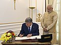 The President of the Republic of Kyrgyzstan, Mr. Almazbek Sharshenovich Atambayev signing the visitor's book, at Hyderabad House, in New Delhi on December 20, 2016. The Prime Minister, Shri Narendra Modi is also seen.jpg