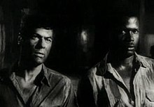 Tony Curtis-Sidney Poitier in The Defiant Ones trailer.jpg