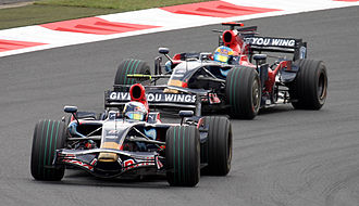 Scuderia Toro Rosso - Sebastian Vettel leads Sébastien Bourdais at the 2008 Japanese Grand Prix.