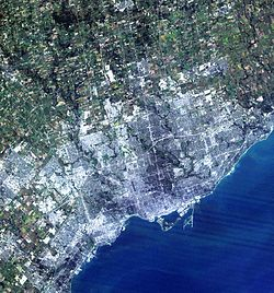 A simulated-colour image of Greater Toronto Area taken by NASA's Landsat 7 satellite from 2004.