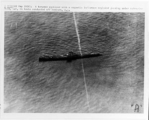 Mark 14 torpedo - The only live fire test of the magnetic influence exploder before the war occurred in 1926.  In this picture of the first shot, the Mark 10 torpedo with the experimental exploder ran underneath the target without exploding.  The second test shot exploded under the target submarine and sank it.  Although the Navy conducted other tests, those tests were nondestructive: the torpedoes would not be damaged by the tests.