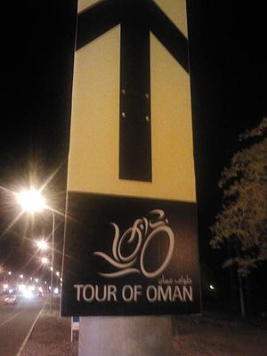 Tour of Oman - Tour of Oman banner on a lighting pole in Nakhl, Oman on February 21, 2014