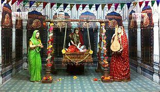 Tulsi Peeth - Moving statues of Kaushalya, Kaikeyi and Sumitra with the infant Rama inside the Manas Bhavan in Tulsi Peeth