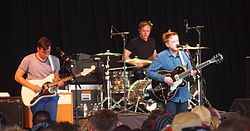 Two Door Cinema Club performing