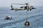 Two MH-60S Sea Hawk helicopters transport cargo to the flight deck of the USS Dwight D. Eisenhower. (29602233896).jpg