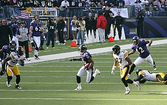 Tyrone Carter - Carter (23) playing against the Baltimore Ravens in 2006.