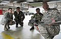 U.S. Air Force Tech. Sgt. John Lyon, foreground, a crew chief with the 52nd Aircraft Maintenance Squadron, explains F-16 Fighting Falcon aircraft capabilities to members of the Romanian air force during 140325-F-NJ596-102.jpg