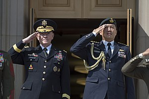 U.S. Army Gen. Martin E. Dempsey, chairman of the Joint Chiefs of Staff, and Singaporean Chief of Defense Force Lt. Gen. Ng Chee Meng salute during an honor cordon on the steps of the Pentagon 140821-D-KC128-08.jpg