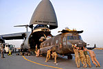 U.S. Army National Guard soldiers push a CH-47 Chinook helicopter into a U.S. Air Force C-5 Galaxy as they prepare to return home to the United States following a nine-month deployment to Afghanistan on April 20 130420-Z-ZZ999-004.jpg