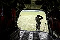 U.S. Army Sgt. Elizabeth Mashaw, a crew chief with Bravo Company, 5th Battalion, 159th Aviation Regiment, waits for supplies to be brought over and loaded onto a CH-47 Chinook helicopter at Camp Atterbury 130813-F-QA406-028.jpg