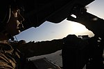 U.S. Marine Corps Cpl. Ryan P. Wells, a crew chief with Marine Heavy Helicopter Squadron (HMH) 462, provides aerial security from inside a CH-53E Super Stallion helicopter over Helmand province, Afghanistan 131007-M-SA716-006.jpg