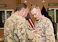 U.S. Marine Corps Gen. Joseph F. Dunford Jr., right, the outgoing commander of the International Security Assistance Force and U.S. Forces-Afghanistan, receives a medal from Supreme Allied Commander Europe U.S 140826-D-HU462-380.jpg
