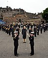 U.S. Naval Forces Europe Band Director Lt. David Latour, left, gives the oath of re-enlistment to Musician 3rd Class Margaret Pedlow after the band rehearsed their segment of the Royal Edinburgh Military Tattoo 120731-N-VT117-1565.jpg